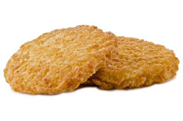 Two chicken patties on a white background.