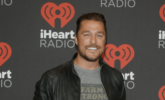 Chris Soules smiles as he stands on a red carpet.
