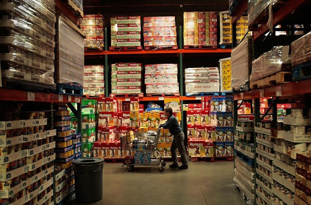 Shopper pushes cart through Costco