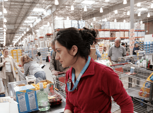 A cashier at Costco rings up a customer.