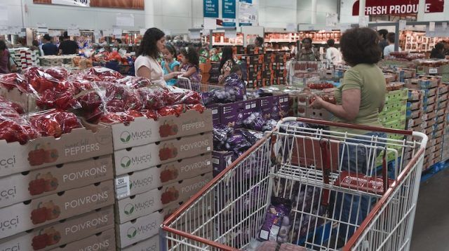 Costco customers picking up produce.