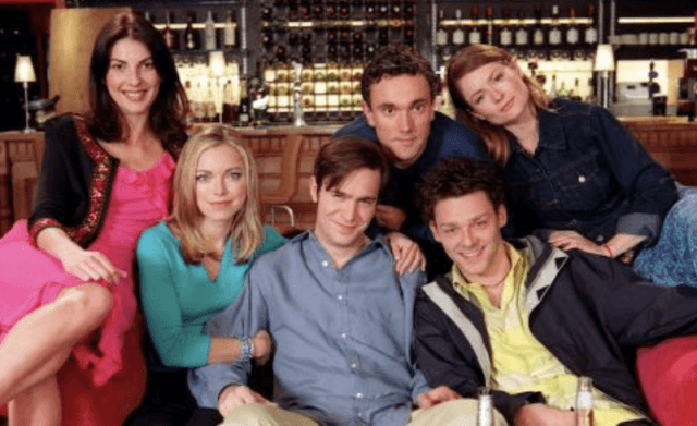 The cast of 'Coupling' sitting together.