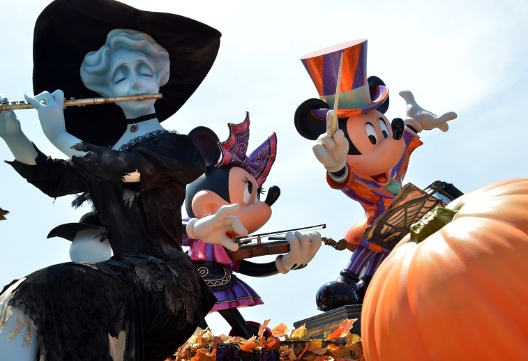 Mickey and Minnie Mouse dressed up for Halloween