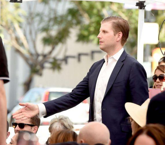 Eric Trump holding out his hand.