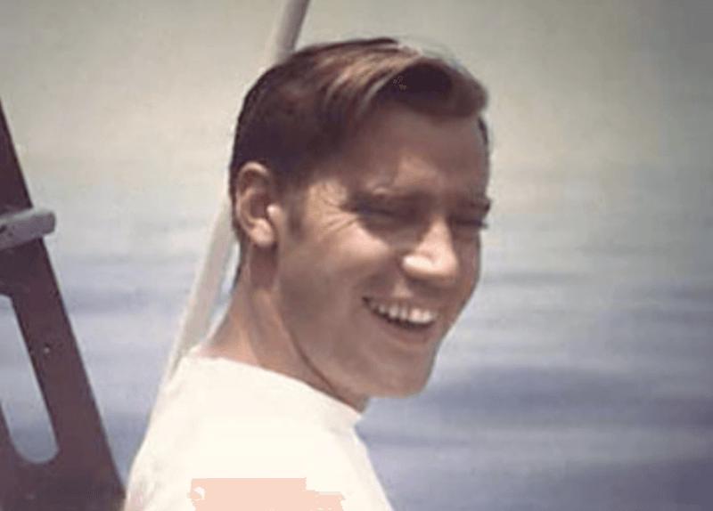 Fred Trump smiling on a boat