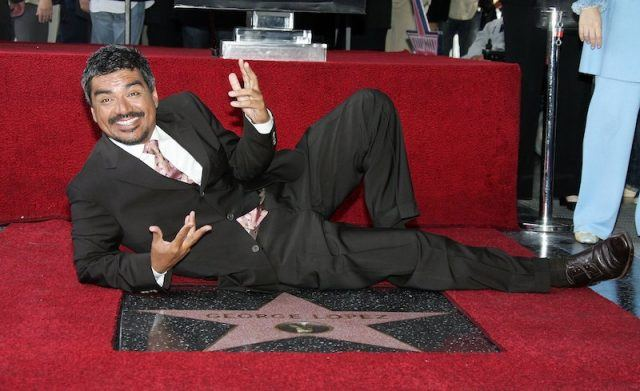 George Lopez smiles as he poses with his star.