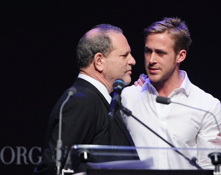 Harvey Weinstein and Ryan Gosling speak during amfAR's Cinema Against AIDS 2010 benefit gala at the Hotel du Cap on May 20, 2010 in Antibes, France.