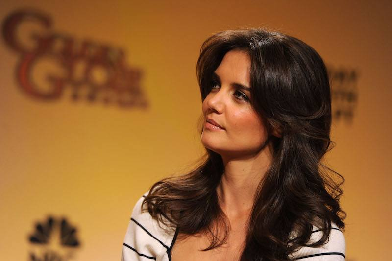 Katie Holmes looks to the side