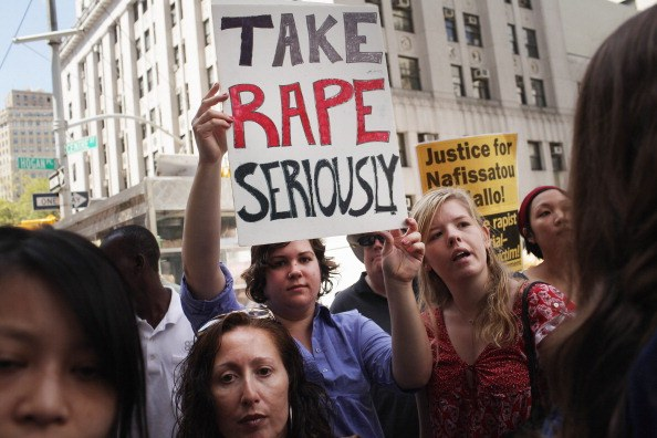 protesters outside a rape trial