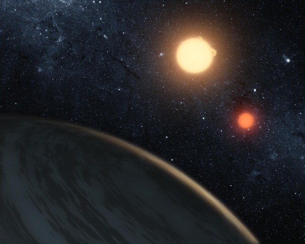 In this handout digital illustration released on September 15, 2011 by NASA, the newly-discovered gaseous planet Kepler-16b orbits it's two stars.