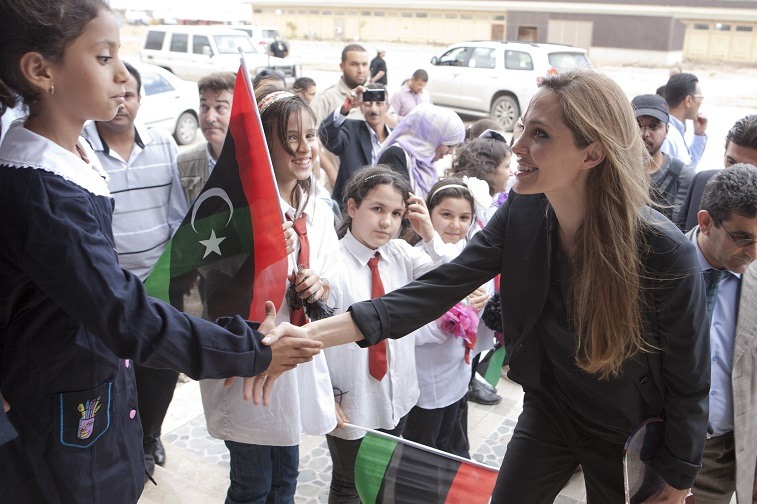 Angelina Jolie shakes hands with a child on October 11, 2011 in Misrata, Libya.