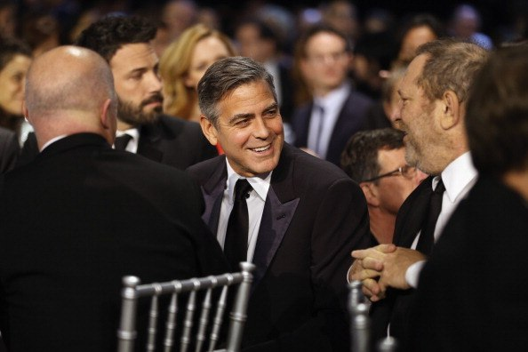 George Clooney and Harvey Weinstein attend the 18th Annual Critics' Choice Movie Awards held at Barker Hangar on January 10, 2013 in Santa Monica, California.