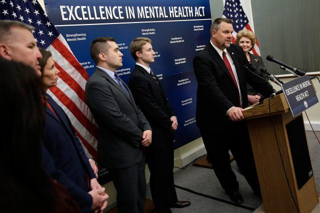 U.S. Sen. Jon Tester (D-MT) (2nd R) speaks during a press conference calling for passage of mental health legislation as part of a gun safety package with U.S. Sen. Debbie Stabenow (D-MI) (R) at the U.S. Capitol