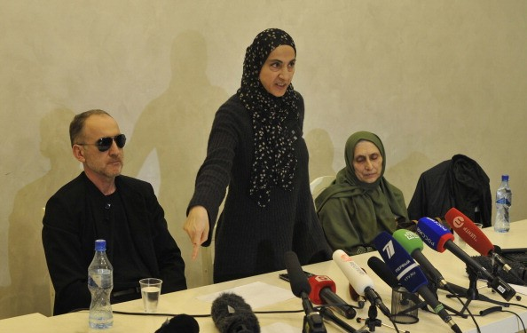 the family of Boston marathon bombers give a press conference behind a row of microphones