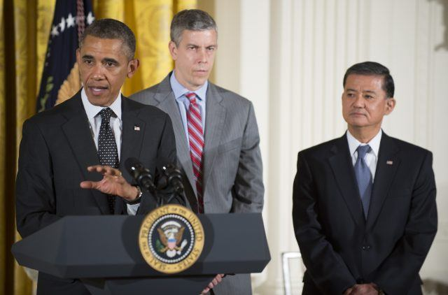 US President Barack Obama (L) delivers remarks with Secretary of Education Arne Duncan (C) and Secretary of Veteran Affairs Eric Shinseki at a conference on mental health at the White House in Washington