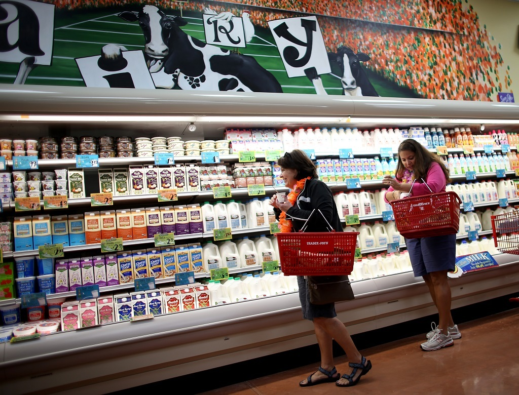 Shoppers enjoy the grand opening of a Trader Joe's on October 18, 2013 in Pinecrest, Florida. Trader Joe's opened its first store in South Florida where shoppers can now take advantage of the California grocery chains low-cost wines and unique items not found in other stores. About 80 percent of what they sell is under the Trader Joe's private label. (Photo by Joe Raedle/Getty Images)