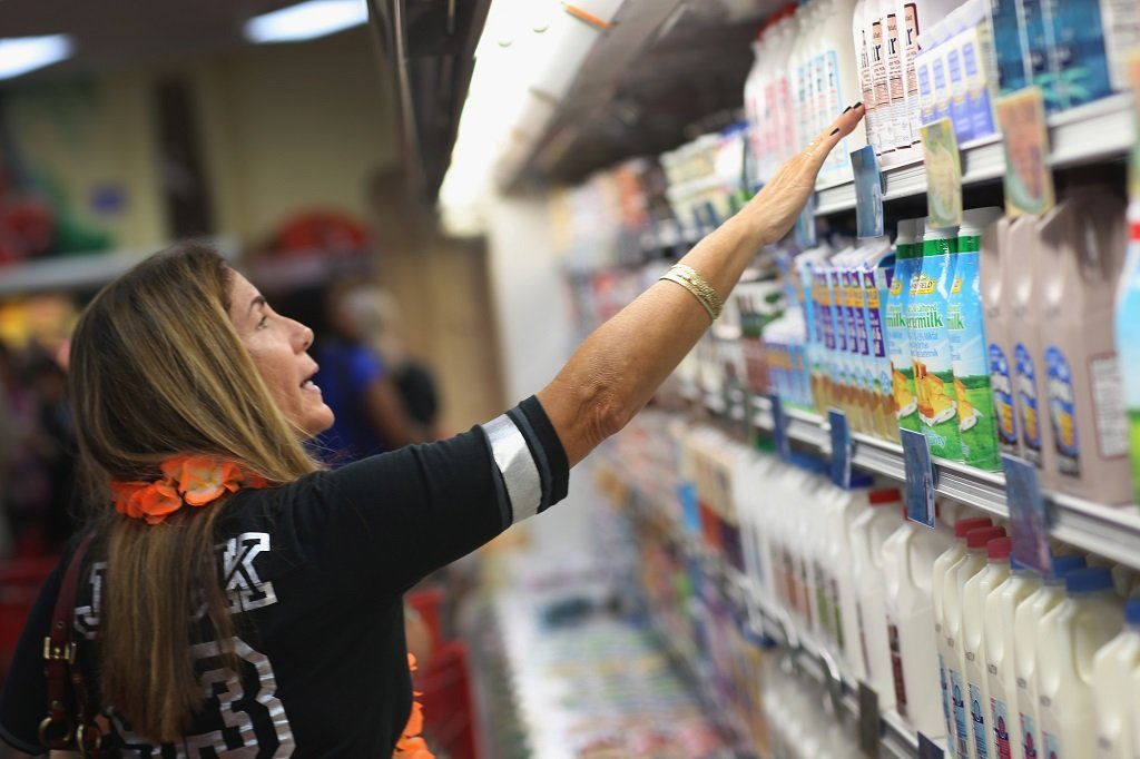Mercy Weaver looks in the dairy section as she enjoys the grand opening of a Trader Joe's on October 18, 2013 in Pinecrest, Florida. Trader Joe's opened its first store in South Florida where shoppers can now take advantage of the California grocery chains low-cost wines and unique items not found in other stores. About 80 percent of what they sell is under the Trader Joe's private label. (Photo by Joe Raedle/Getty Images)