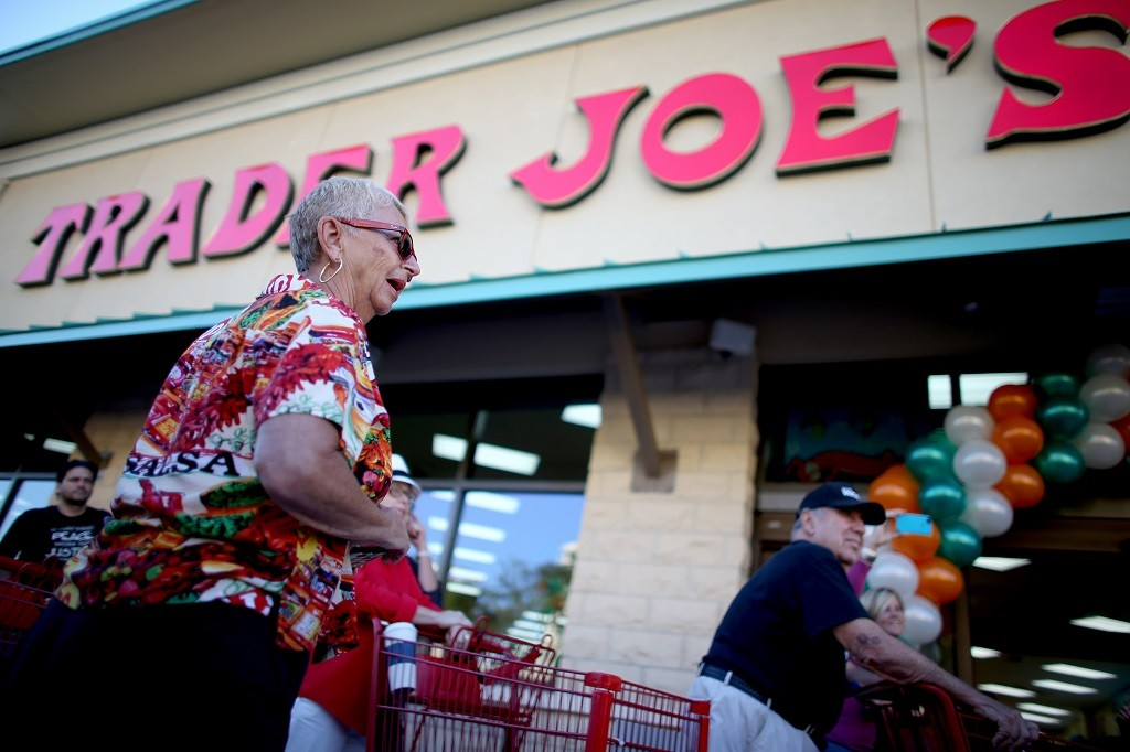 Shoppers lineup as they wait for the grand opening of a Trader Joe's on October 18, 2013 in Pinecrest, Florida. Trader Joe's opened its first store in South Florida where shoppers can now take advantage of the California grocery chains low-cost wines and unique items not found in other stores. About 80 percent of what they sell is under the Trader Joe's private label. (Photo by Joe Raedle/Getty Images)