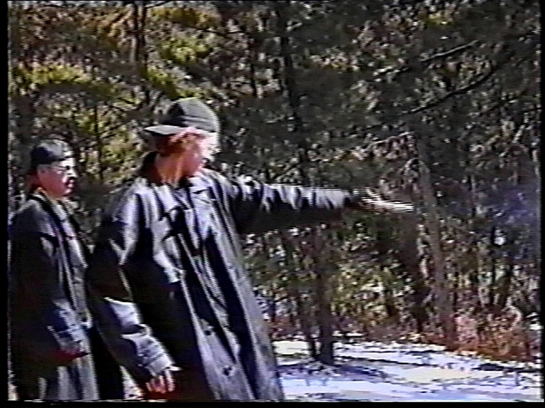 the columbine killers practice at a gun range in black trench coats