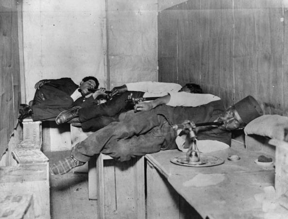 men in black and white smoking opium