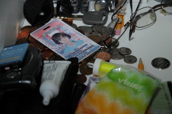 adam lanza's school ID in a jumble of bottles, coins, keys, glasses