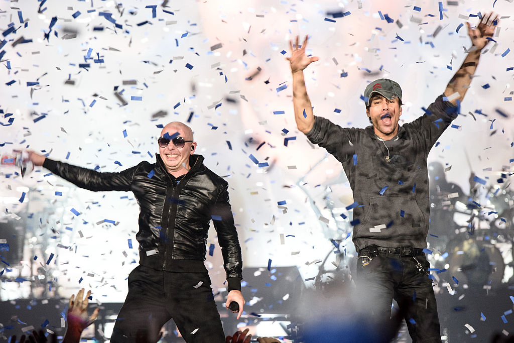 Enrique Iglesias and Pitbull dancing in graffiti on a white background