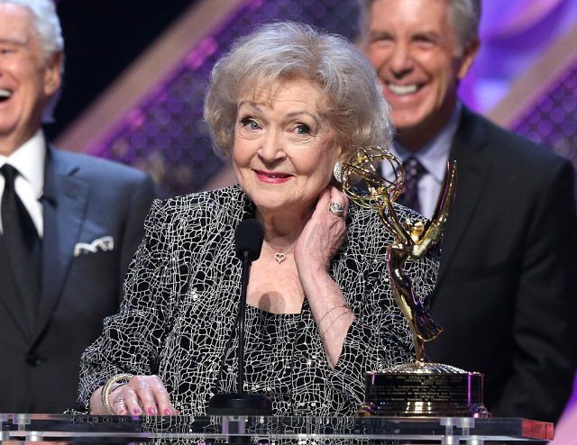 Betty White speaking on stage while accepting an award.