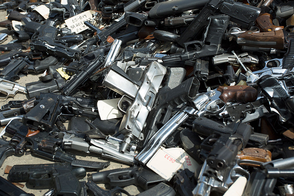 a pile of surrendered guns at an event for surrendering them