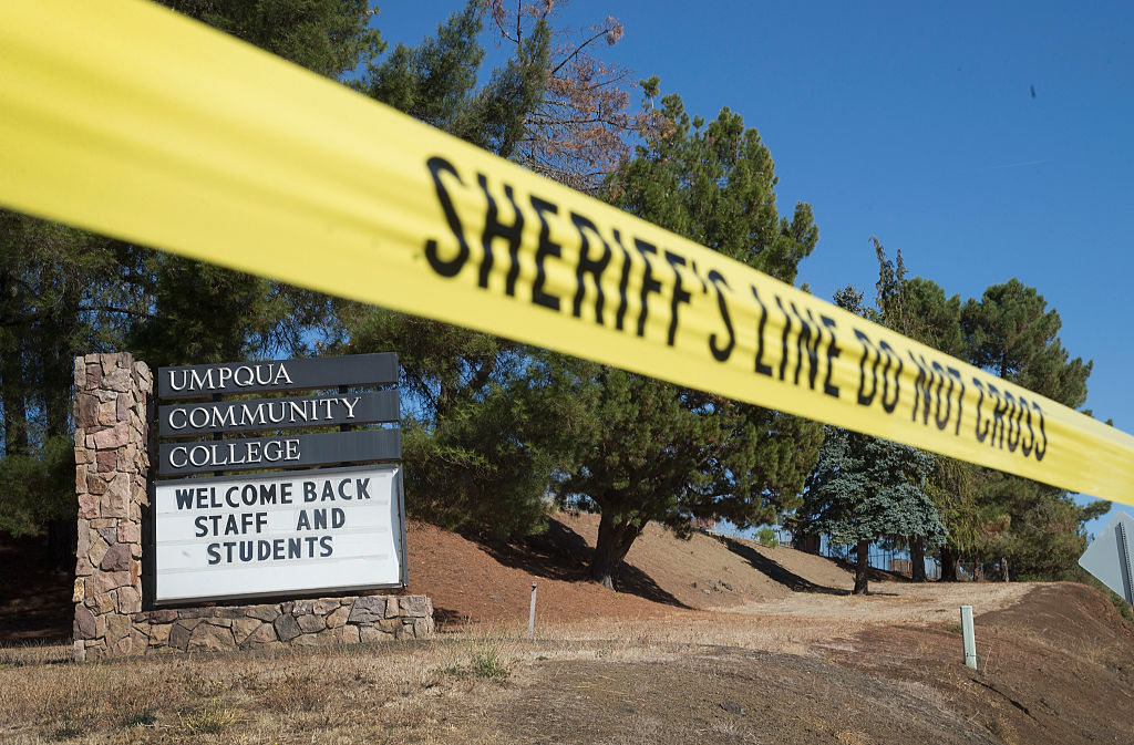 a welcome back sign at umpqua college with police tape