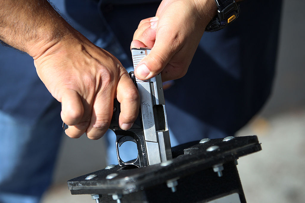cop clearing a surrendered gun