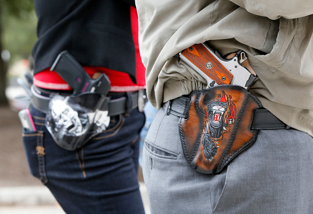 guns in holsters