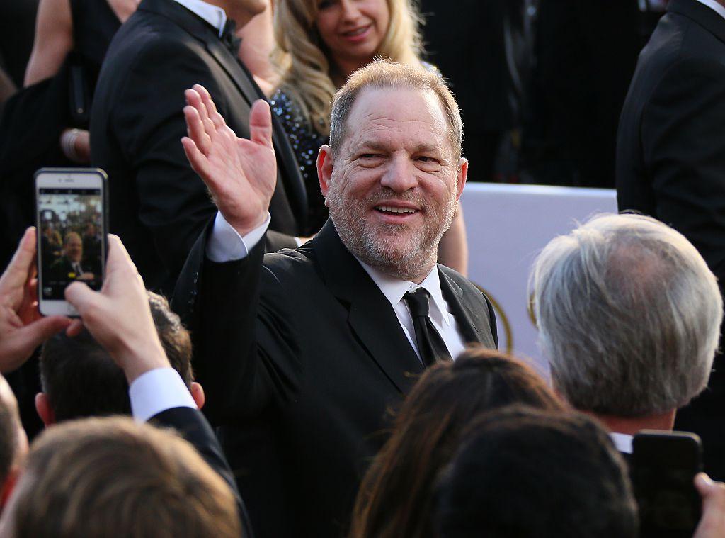 Harvey Weinstein with reporters