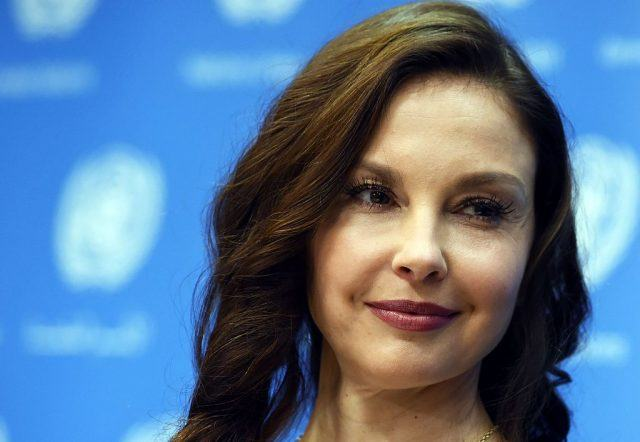 Ashley Judd's face against a blue background.