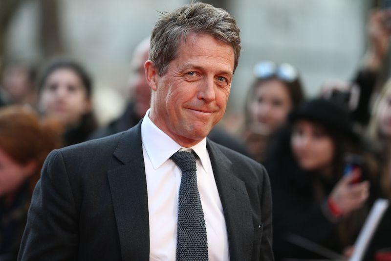 British actor Hugh Grant poses on arrival for the premiere of Florence Foster Jenkins in London on April 12, 2016. / AFP / JUSTIN TALLIS (Photo credit should read JUSTIN TALLIS/AFP/Getty Images)