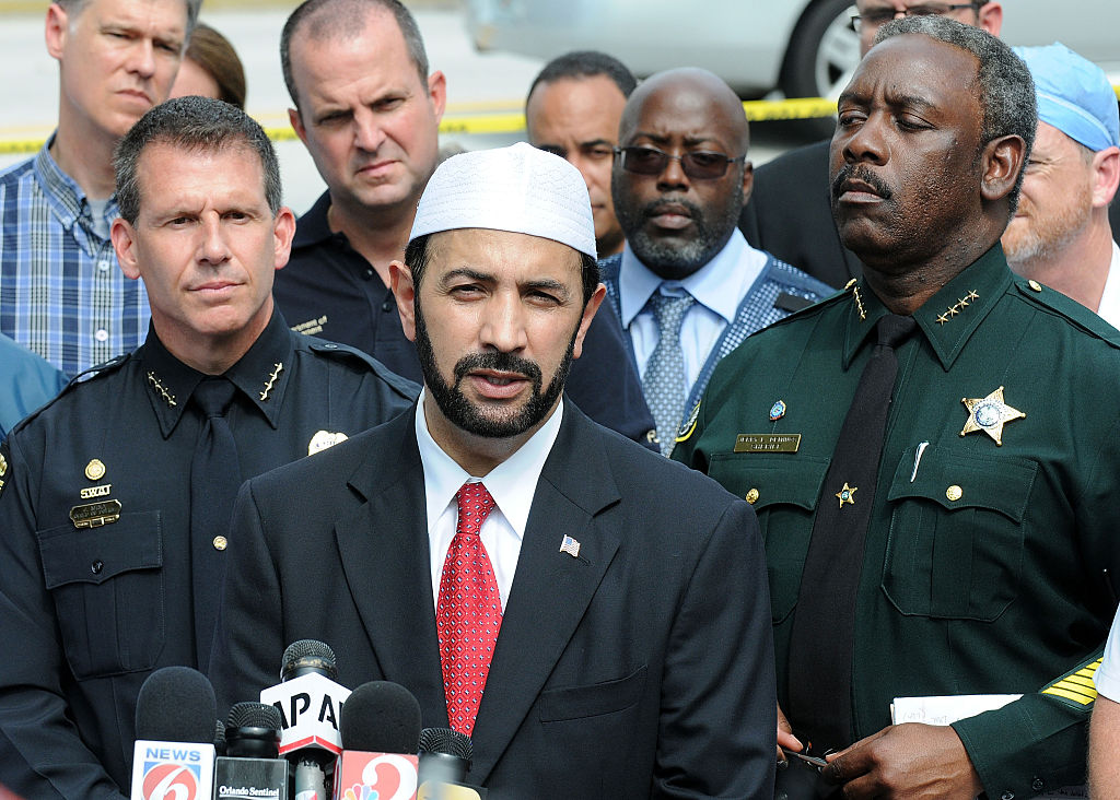 The Iman of the Islamic Society of Central Florida speaks with law enforcement