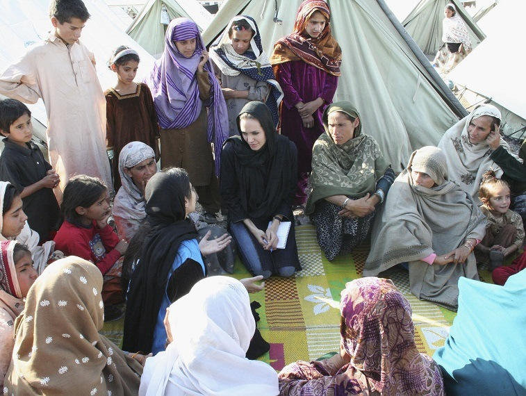 Goodwill Ambassador Angelina Jolie talks with refugees