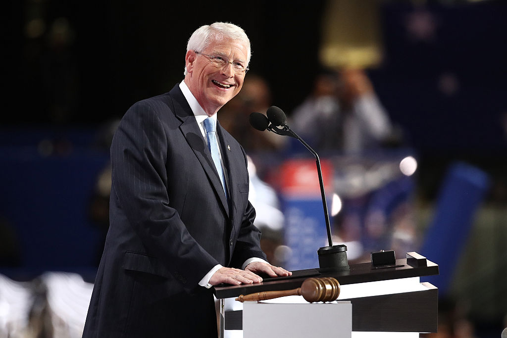 Roger Wicker at a white podium in a dark suit