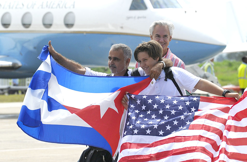 Cuban and American flags and airplane