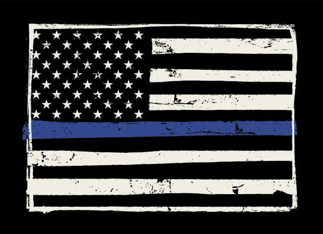 A black and white United States flag with a blue horizontal stripe in the middle