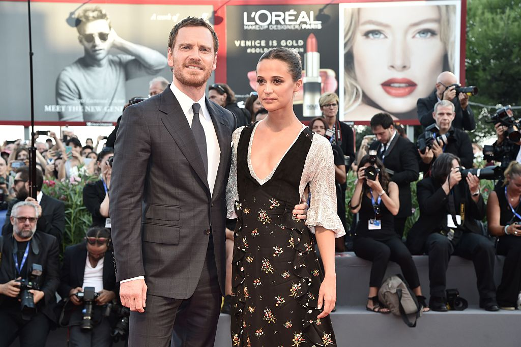 Michael Fassbender and Alicia Vikander pose together