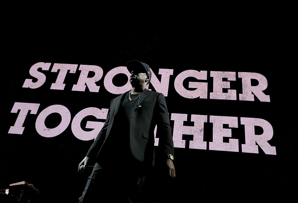Jay Z in front of a stronger together sign