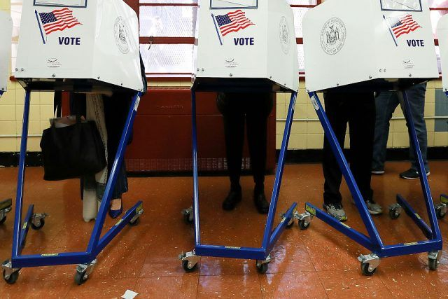 Voters cast their ballots at voting booths