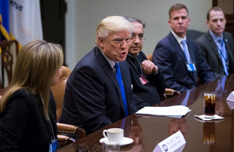 President Donald Trump meets with CEO of General Motors Mary Barra (L), CEO of Fiat Chrysler Automobiles Sergio Marchionne (3rd R) and Fiat Chrysler Head of External Affairs Shane Karr (2nd R) in the Roosevelt Room of the White House on January 24, 2017 in Washington, DC.