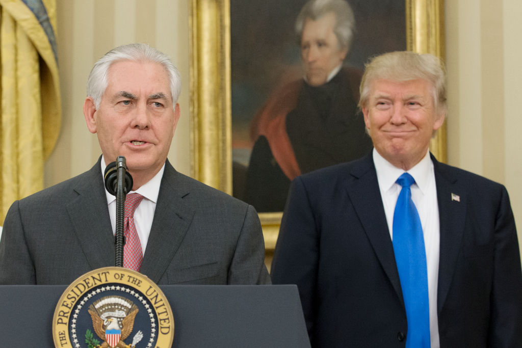 Rex Tillerson delivers remarks after being sworn in as 69th secretary of state as President Donald Trump looks on beneath a painting of populist President Andrew Jackson in the Oval Office of the White House.
