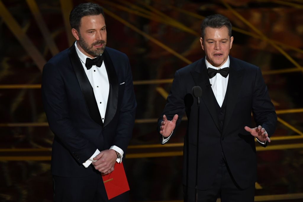 Ben Affleck and Matt Damon in tuxedos onstage
