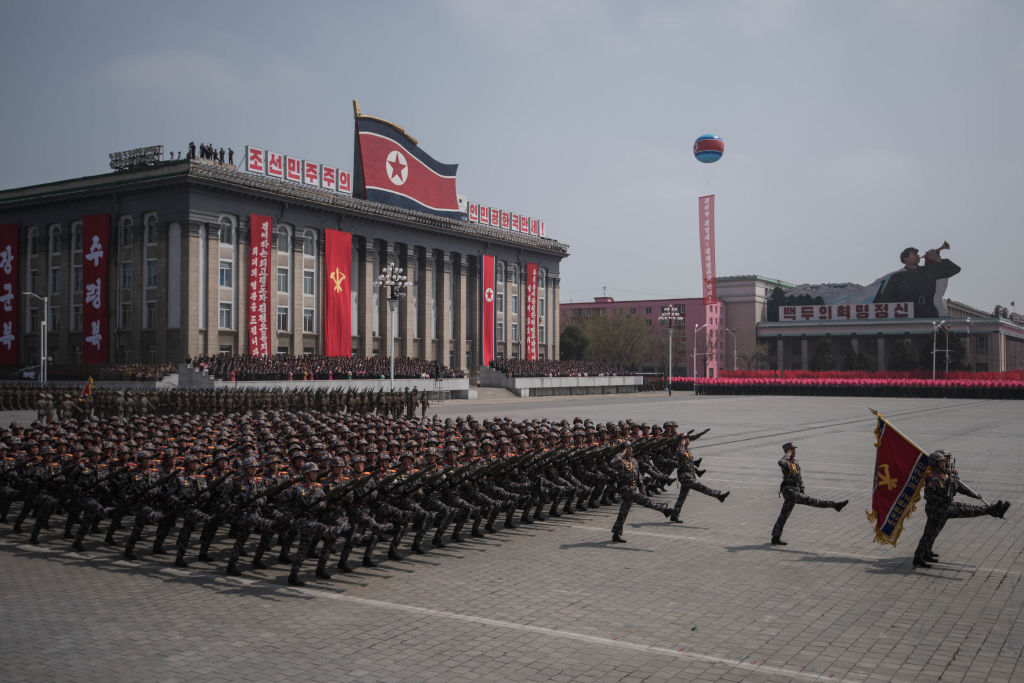 north korea military marching at the capitol