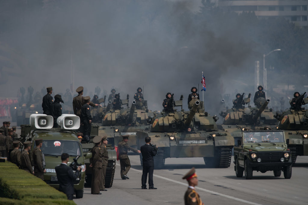 north korea military soldiers with tanks and smoke