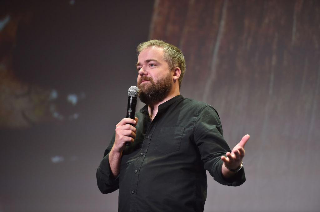 David F. Sandberg speaks into a microphone on stage.