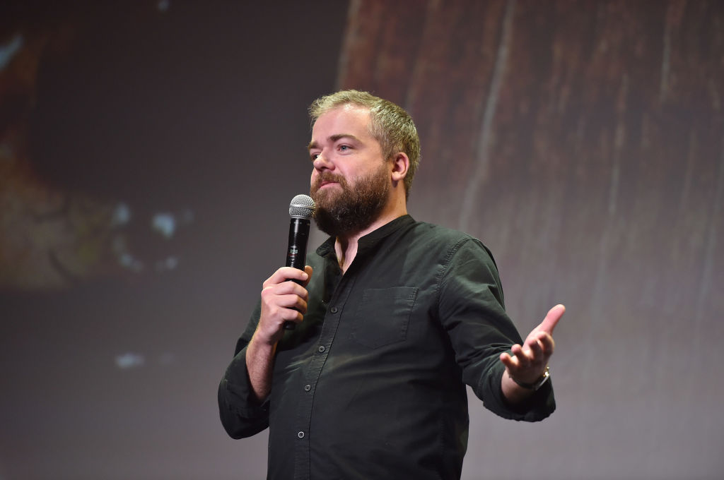 David F. Sandberg speaks into a microphone on stage.