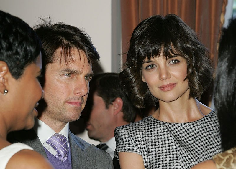Tom Cruise (L) and Katie Holmes (R) arrive at the First Annual Essence Black Women In Hollywood Luncheon